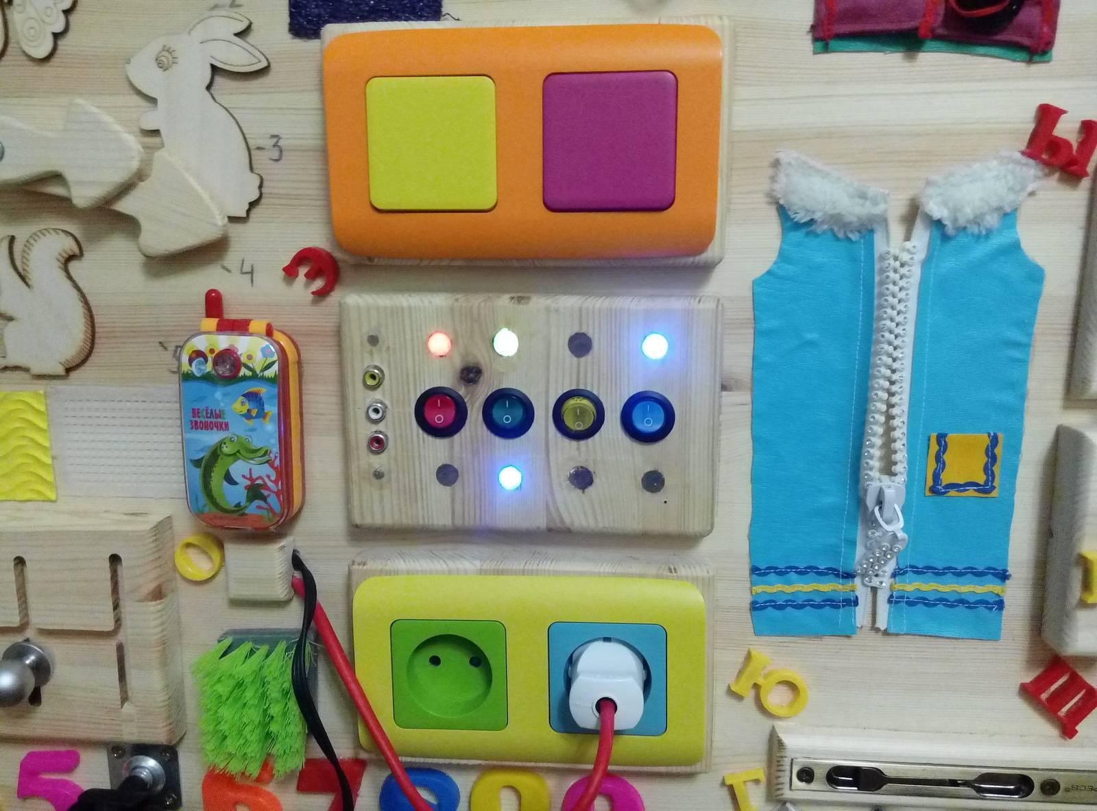 Развивающие доски с замочками для детей (35 фото): идеи бизибордов