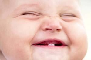 Зубы: признаки появления у грудничка