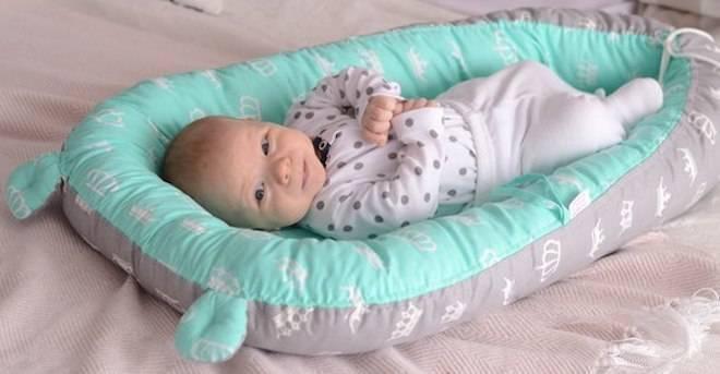 Виды кокона для новорожденных, способы применения, схема вязания и пошива своими руками, польза и вред